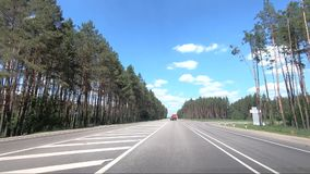 Movement on asphalt car road and clouds on blue sky in summer day. Movement on asphalt car road and clouds on blue sky in summer day stock video footage