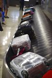 The movement of baggage on a conveyor belt royalty free stock photography