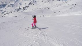 In Movement Beginner Woman Skier Down The Long Turns On The Slope Of A Mountain
