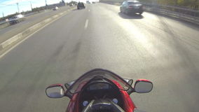 The movement on the bike. Filmed in motion on a motorcycle in busy city traffic stock video
