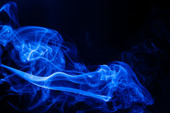 Movement blue smoke. On black background Royalty Free Stock Photography