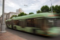Movement of a blurry bus in the street. During the day royalty free stock photo