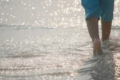 Movement of a boy in the walk on the sea Royalty Free Stock Photography