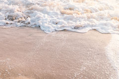 Movement of calm sea wave. On the beach stock photography