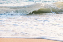 Movement of calm sea wave. With white foam on the beach stock photography