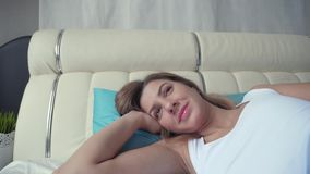 Movement Camera To Face Of A Sleeping Woman Wakes Up Opens Her Eyes And Smiles stock video