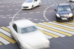 Movement of car at  intersection in city. High-speed movement of car at automobile intersection in city Stock Photography