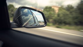 Movement in the car mirror, View of the road stock video footage