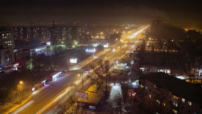 The movement of cars on the night street. Time Lapse Of City Road Night Traffic stock footage