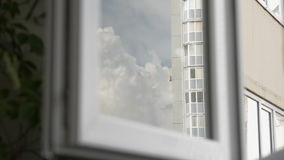 Movement of the cloud reflected in the window stock footage