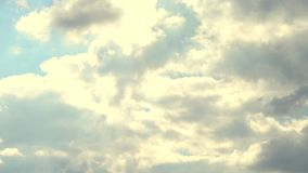 Movement of clouds on a blue sky. Abstract movement of clouds on a blue sky. Fast movement of rainy clouds in the sky close-up abstract background, rainy weather stock footage