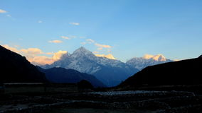Movement of the clouds on the mountains Thamserku, Kantaiga, Himalayas, Nepal Stock Photo