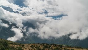 The movement of clouds over the highland valley. Time lapse. Nepal stock video footage