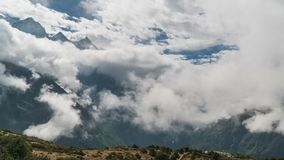 The movement of clouds over the highland valley. Time lapse zoom in. The movement of clouds over the highland valley. Nepal stock footage