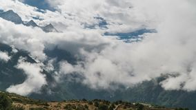 The movement of clouds over the highland valley. Time lapse zoom out. The movement of clouds over the highland valley. Nepal stock video