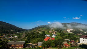 The movement of clouds over houses in the mountains, the movement of the train stock video