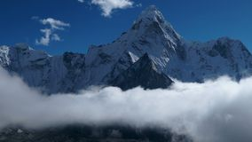 The movement of clouds over the mountain Ama Dablam stock footage