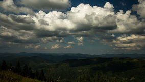 Movement of the clouds over the mountains, shadows from clouds on the mountains stock footage