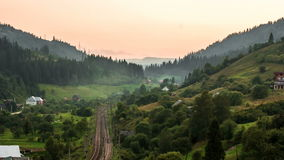 The movement of clouds over the mountains with trees, the movement of the trains stock video