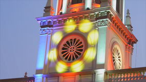 Movement of colorful lighting on top of church stock video footage