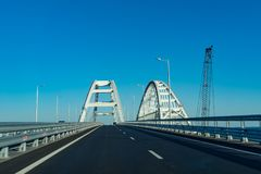 Movement on the Crimean bridge in the daytime against the blue sky. Kerch, Crimea: June 2, 2018: Movement on the Crimean bridge in the daytime against the blue stock images