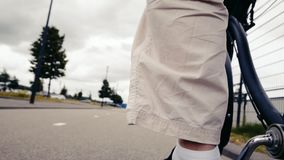 The movement of the cyclist on the asphalt from the first person. Rear view stock video