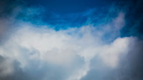 The Movement of the Dark Rain Clouds. Cumulus clouds cover the sun's rays, TimeLapse stock footage