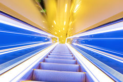 Movement of diminishing hallway escalator Stock Images