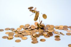 Movement of falling gold coin, flying coin, rain money with soft shadow on white background, business and financial wealth and. Take profit concept idea royalty free stock image