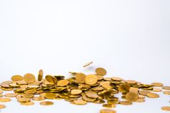 Movement of falling gold coin, flying coin, rain money with soft shadow on white background, business and financial wealth and. Take profit concept idea stock image