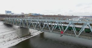 Movement of freight train through the railway bridge. Shooting with DJI Inspire x3 or OSMO x3 at winter 2016 stock footage