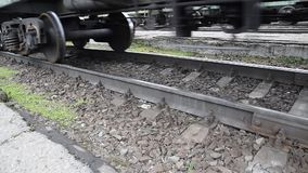 Movement of a freight train. Tanks on rails. Wheels of the train.  stock footage