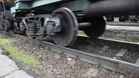Movement of a freight train. Tanks on rails. Wheels of the train.  stock video
