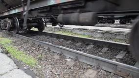 Movement of a freight train. Tanks on rails. Wheels of the train.  stock video footage