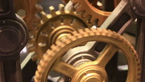 Movement of gears in working clockwork close up stock footage