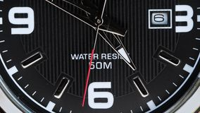The movement of the hands of a wristwatch. The movement of the hands of a quartz wrist watch. Close up. Business concept and time limit stock footage