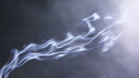 Movement of Incense Smoke on a dark background