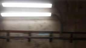 Movement inside an illuminated railway tunnel stock video