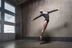 Movement, jumping concept. Woman dancing contemporary. In studio royalty free stock photos