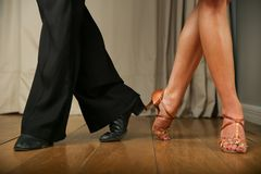 Movement of the legs of a dancing couple. stock images