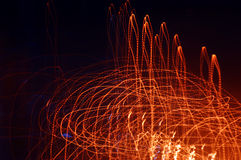 Movement of light. It is red orange beams against a dark background Royalty Free Stock Photo