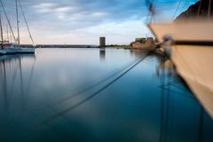 Movement by long shutter, clear water. Long shutter, moving boat clear water. sunset and water reflection. landmark on the back royalty free stock image