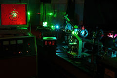 Movement of microparticles by laser in lab. Movement of microparticles by laser in dark lab with timer Stock Photos