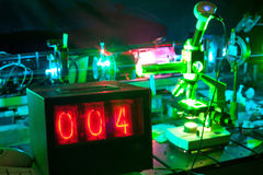 Movement of microparticles by laser in lab. With timer Royalty Free Stock Images