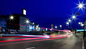 Movement at night on the town road junction. Photo for slow shutter speeds Stock Photos
