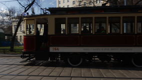 Movement of old trams through the city streets stock video