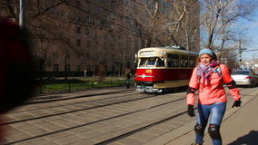Movement of old trams through the city streets stock video footage