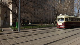 Movement of old trams through the city streets stock footage
