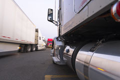 Movement and parking of semi trucks at truck stop Stock Photography