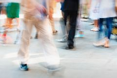 Movement of pedestrians on the sidewalk Stock Photography
